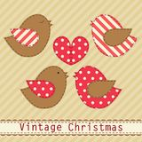 Cute fabric paradise birds as retro fabric applique in shabby chic style in traditional Christmas colors Royalty Free Stock Photo