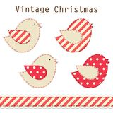 Cute fabric paradise birds as retro fabric applique in shabby chic style in traditional Christmas colors Stock Image