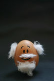 Cute face drawn on egg. Old man face drawn on egg Royalty Free Stock Image