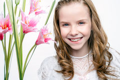 Cute face shot of communion girl with flowers. Close up studio beauty portrait of cute communion girl with flowers Stock Photography