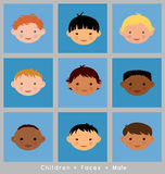 Cute faces of boys of different ethnicity Royalty Free Stock Photo