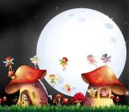 Cute fairies flying over mushroom house Stock Photos