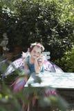 Cute Fairy Girl At Garden Table Stock Photo