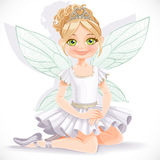 Cute fairy girl in tiara sit on floor Stock Photos