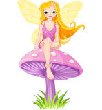 Cute Fairy on the Mushroom Stock Images