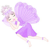 Cute fairy in violet dress with wings is sleeping Royalty Free Stock Photo