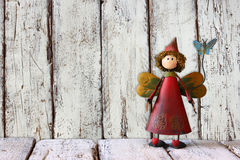 Cute fairy on wooden table and background Royalty Free Stock Photos