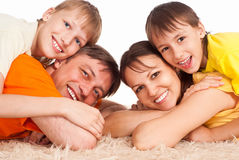 Cute family on carpet Royalty Free Stock Images