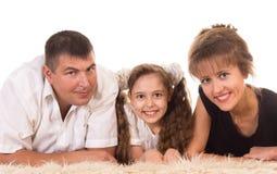 Cute family on carpet Royalty Free Stock Photos