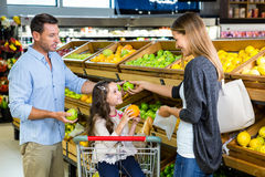 Cute family choosing groceries together Royalty Free Stock Photos