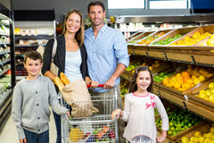 Cute family choosing groceries together Royalty Free Stock Photography