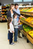 Cute family choosing groceries together Stock Image