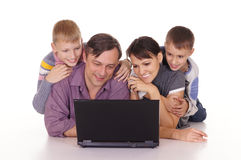 Cute family with computer Stock Photo