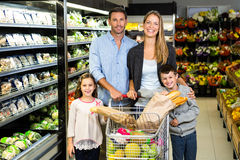 Cute family doing grocery shopping together Stock Photo