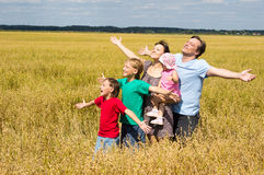 Cute family at field Stock Photo