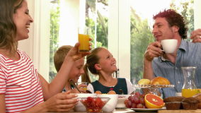 Cute family having breakfast. In the kitchen stock footage