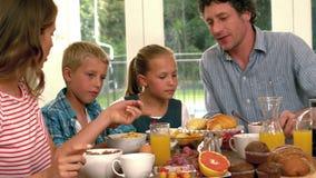 Cute family having breakfast stock video footage
