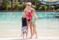 Cute Family at a large outdoor swimming pool Stock Image