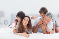 Cute family lying together Royalty Free Stock Image