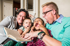 Cute Family Making Faces Stock Photos