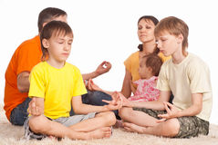 Cute family meditation Royalty Free Stock Image