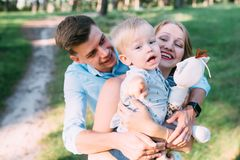 A cute family - mom, dad and son spend fun time in nature.  royalty free stock image