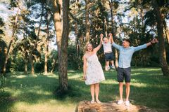 A cute family - mom, dad and son spend fun time in nature.  royalty free stock images