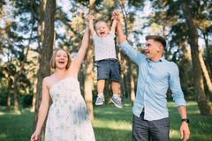 A cute family - mom, dad and son spend fun time in nature stock image