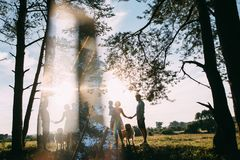 A cute family - mom, dad and son spend fun time outdoors with their dog.  royalty free stock photo
