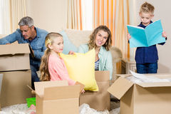 Cute family opening boxes Royalty Free Stock Photo