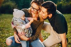 Family spend time in a park. Cute family in a park. Beautyful mother with her little daughter. Woman in a glasses stock photos