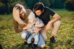 Family spend time in a park. Cute family in a park. Beautyful mother with her little daughter. Woman in a glasses stock photography