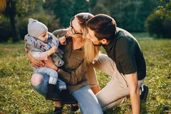 Family spend time in a park. Cute family in a park. Beautyful mother with her little daughter. Woman in a glasses royalty free stock image