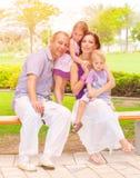 Cute family in the park Stock Photos