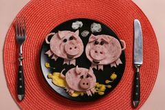 Cute family of pigs - breakfast for children from ham and omelette, culinary idea royalty free stock photos