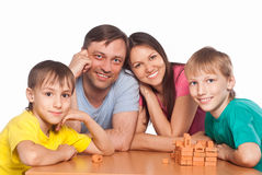 Cute family playing at table Stock Image