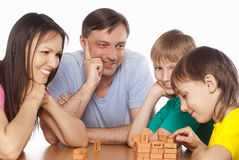 Cute family playing at table Royalty Free Stock Photo