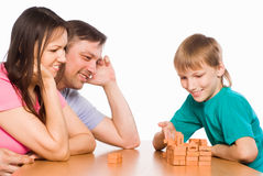 Cute family playing at table Royalty Free Stock Photography