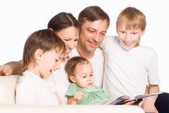 Cute family reading Stock Photos