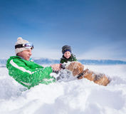 Cute family scene: father and son play with dog during mountain Royalty Free Stock Photography