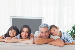 Cute family in sitting room smiling at camera Royalty Free Stock Image