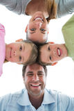 Cute family smiling down at camera together Royalty Free Stock Photo