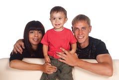 Cute family of a three Royalty Free Stock Photos