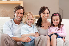 Cute family watching television together Stock Photography