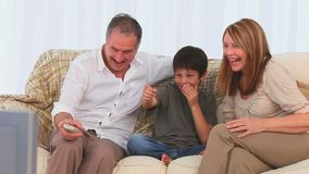 Cute family watching the tv