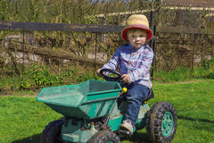Cute farm boy. Cute toddler on a tractor Royalty Free Stock Photography