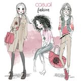 Cute cartoon hipster girls. Cute fashion cartoon girls in sketchy style Royalty Free Stock Images