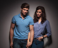 Cute fashion couple looking at the camera Royalty Free Stock Photos