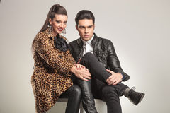 Cute fashion couple sitting Stock Photography