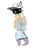 Cute fashion dog in hat and jeans skirt and shirt. Stock Image